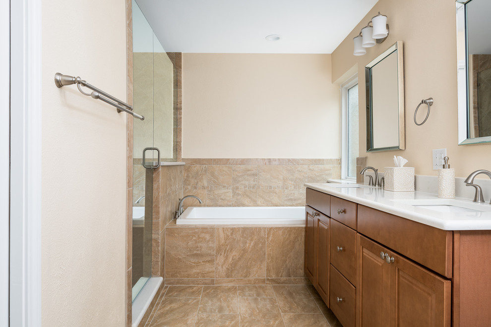 Bathroom - mid-sized contemporary master white tile porcelain tile and beige floor bathroom idea in Dallas with shaker cabinets, brown cabinets, a one-piece toilet, blue walls, an undermount sink, marble countertops and a hinged shower door