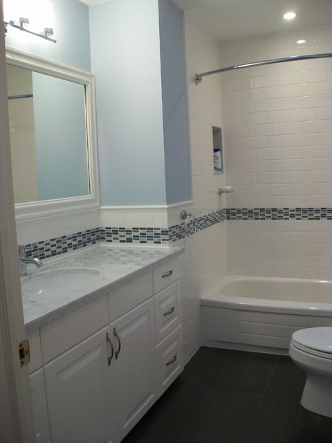 Bathroom Reno With Subway Tile And Blue Accents