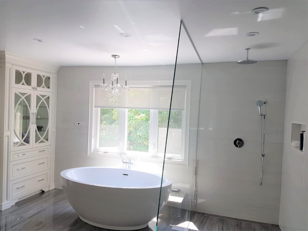 Bathroom shower wall and floor using marble, glass, ceramic and porcelain tiles