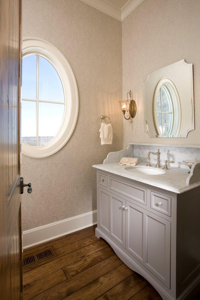 Inspiration for a timeless bathroom remodel in Minneapolis with marble countertops