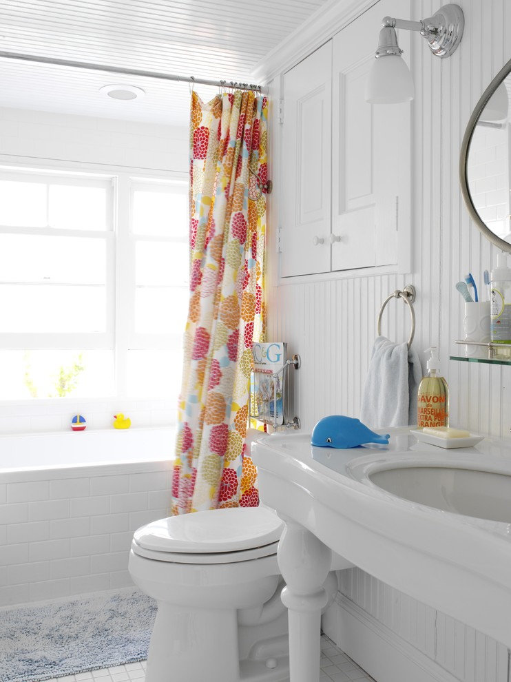 Example of a mid-sized beach style kids' white tile and subway tile porcelain tile bathroom design in New York with a console sink, raised-panel cabinets, white cabinets, a two-piece toilet, white walls and solid surface countertops