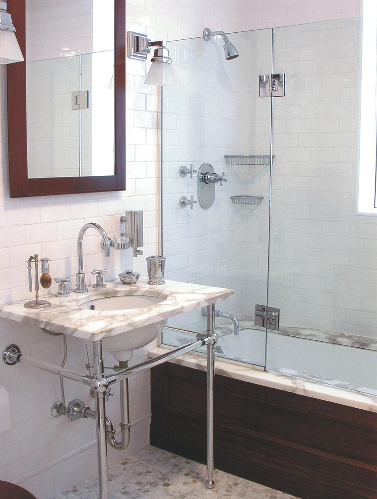 Inspiration for a mid-sized timeless master subway tile and white tile marble floor bathroom remodel in New York with a console sink, open cabinets, white walls and marble countertops