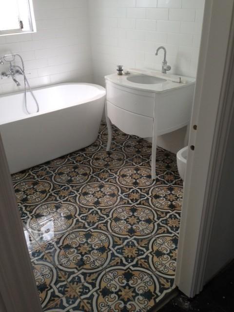 Inspiration for a mediterranean ceramic tile bathroom remodel in Sydney