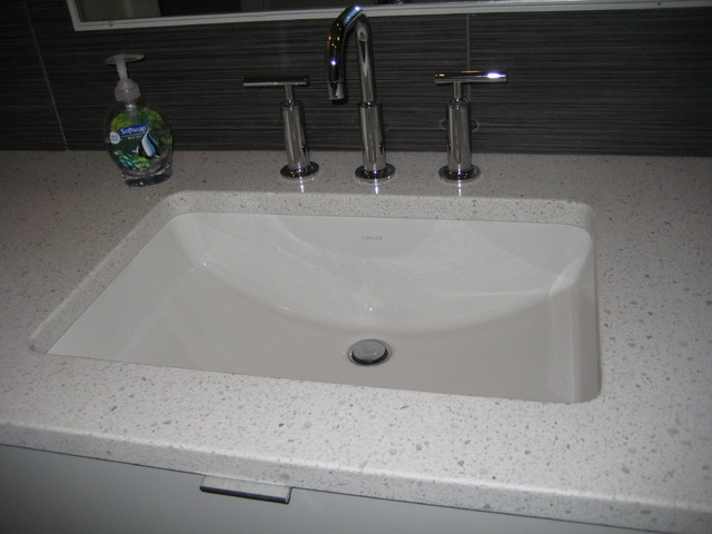 Example Of A Minimalist Bathroom Design In New Orleans With Engineered Quartz Countertops