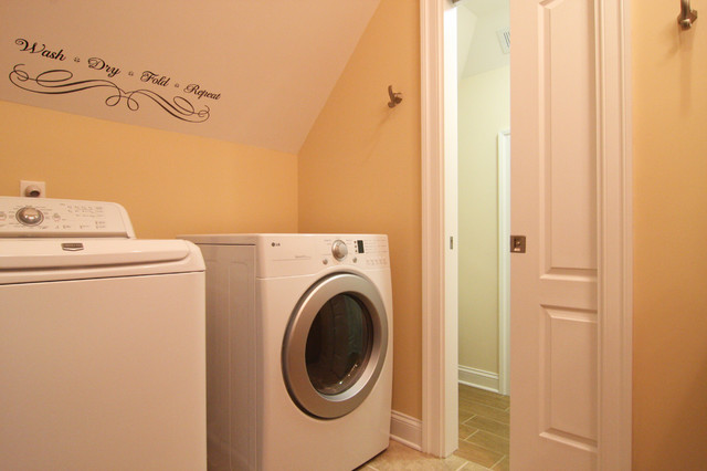 Pocket door leads to bathroom conversion contemporary laundry room