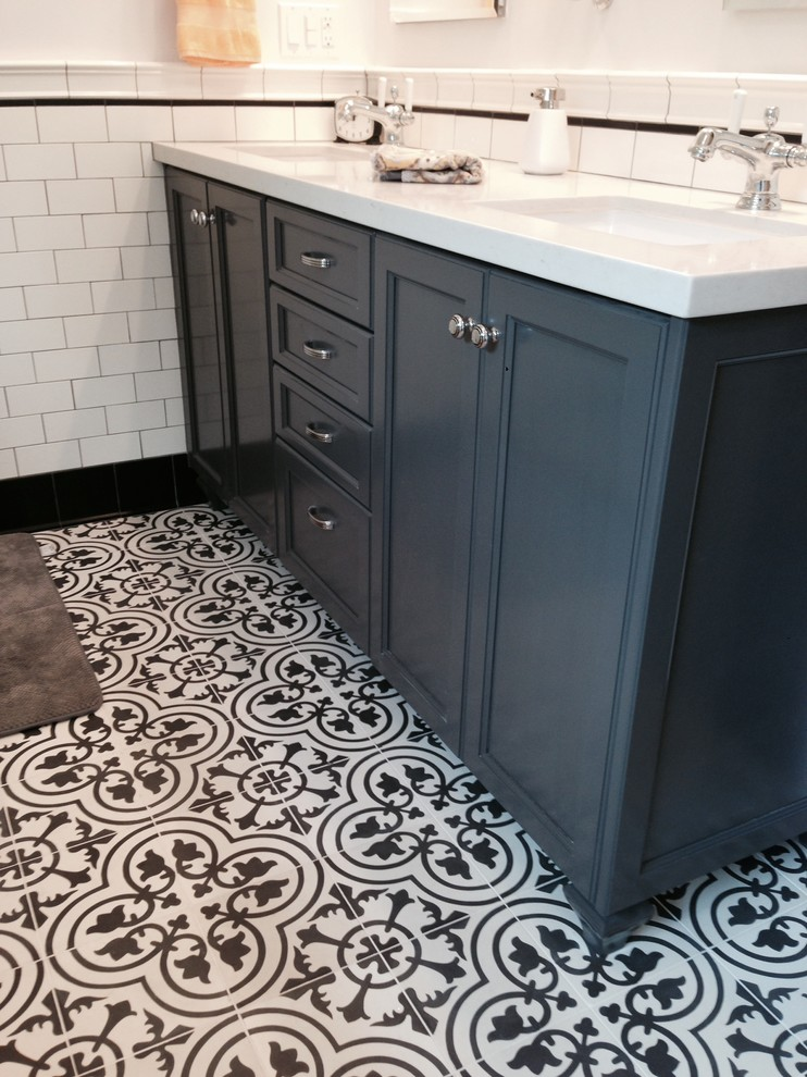 Inspiration for a mid-sized timeless master black tile, black and white tile, white tile and subway tile ceramic floor bathroom remodel in Los Angeles with recessed-panel cabinets, blue cabinets, white walls, an undermount sink and limestone countertops