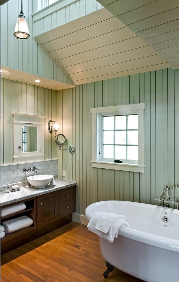 Coastal claw-foot bathtub photo in Portland Maine with a vessel sink and green walls