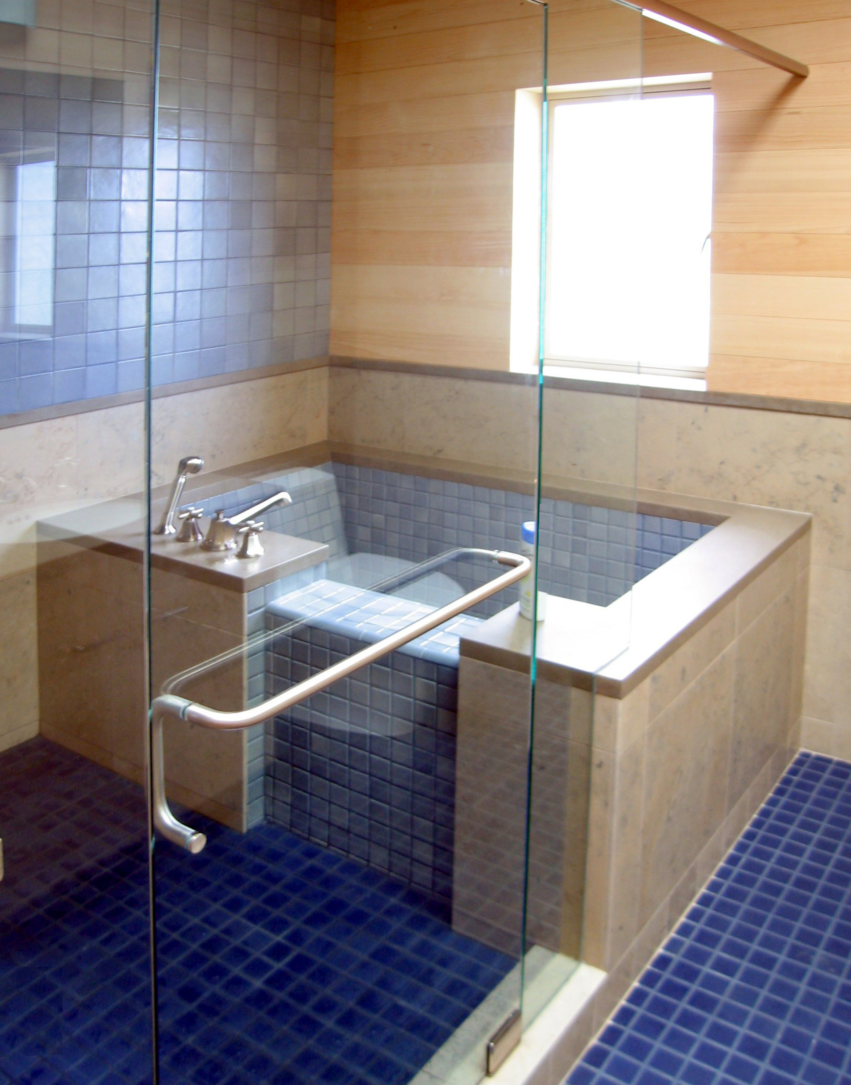 Bathroom with blue tile and large soaking tub