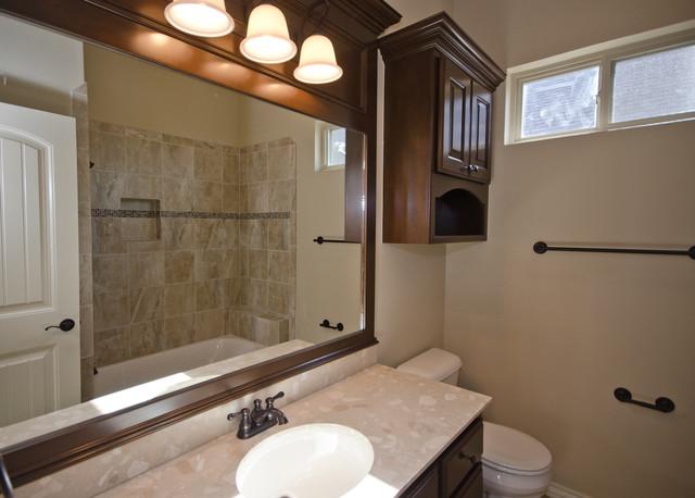 bathroom with dark wood trim around mirror transitional