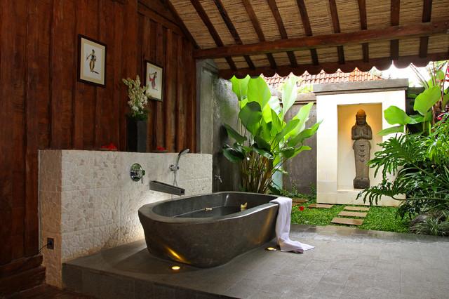 Island style pebble tile freestanding bathtub photo