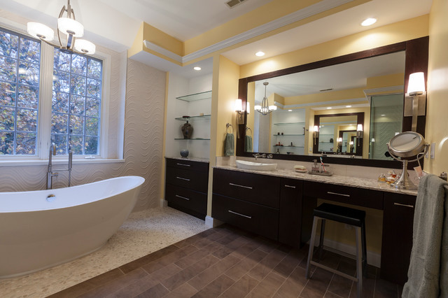 Inspiration for a large contemporary master beige tile and porcelain tile porcelain floor bathroom remodel in New York with a vessel sink, flat-panel cabinets, dark wood cabinets, onyx countertops and yellow walls