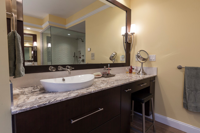 Bathroom - large contemporary master beige tile and porcelain tile porcelain floor bathroom idea in New York with a vessel sink, flat-panel cabinets, dark wood cabinets, onyx countertops, a bidet and yellow walls