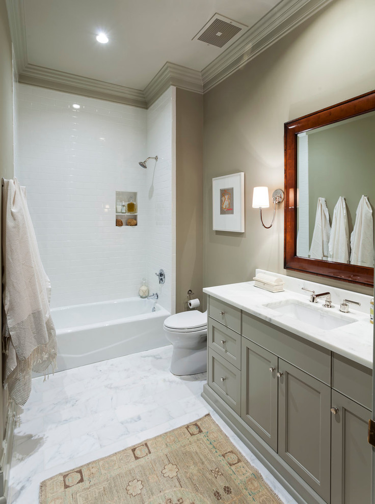 Elegant white tile bathroom photo in Charlotte with an undermount sink and beige walls