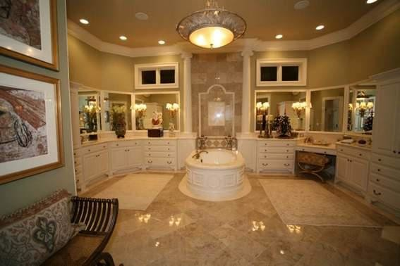 Example of a huge classic master stone tile marble floor bathroom design in Indianapolis with an undermount sink, furniture-like cabinets and granite countertops