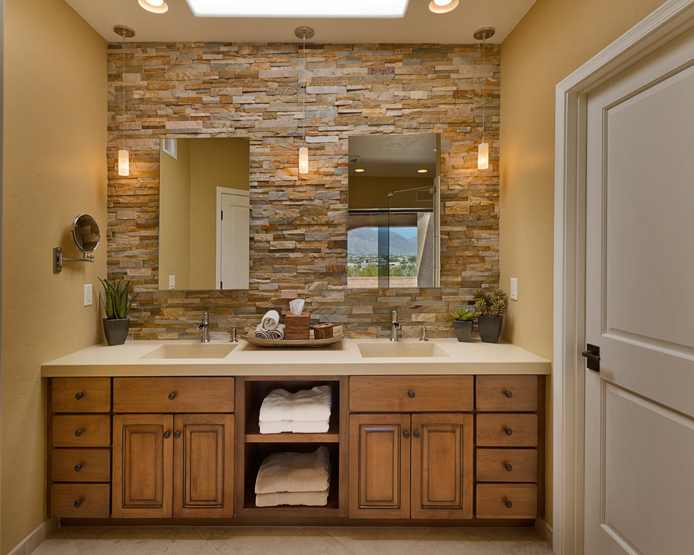Inspiration for a timeless brown tile bathroom remodel in Phoenix with an integrated sink, raised-panel cabinets, medium tone wood cabinets and quartz countertops