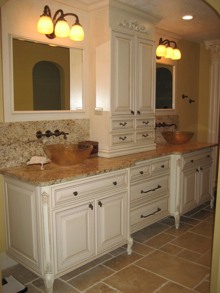 Example of a large classic master bathroom design in Orlando with raised-panel cabinets, white cabinets and a vessel sink