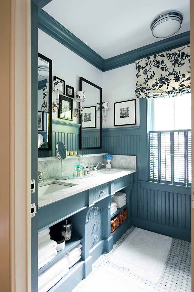 Bathroom - traditional bathroom idea in Other with open cabinets, marble countertops and blue cabinets
