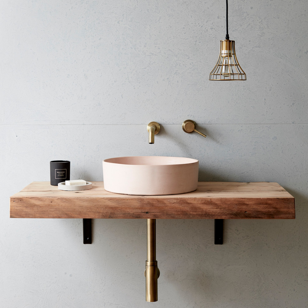 Photo of an industrial bathroom in Gold Coast - Tweed with flat-panel cabinets, medium wood cabinets, grey walls, a vessel sink and wood benchtops.