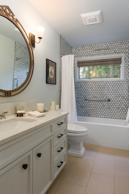 Mid-sized transitional gray tile and porcelain tile porcelain floor and beige floor bathroom photo in Seattle with recessed-panel cabinets, gray cabinets, a one-piece toilet, gray walls, an undermount sink and engineered quartz countertops