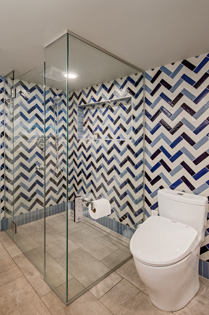 Inspiration for a mid-sized eclectic 3/4 blue tile and porcelain tile porcelain floor and gray floor walk-in shower remodel in Seattle with flat-panel cabinets, white cabinets, a one-piece toilet, gray walls, a vessel sink, engineered quartz countertops and a hinged shower door