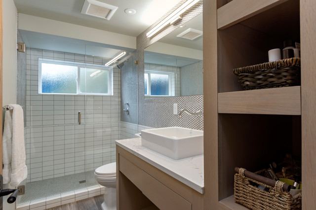 Inspiration for a mid-sized transitional 3/4 white tile and ceramic tile porcelain floor and brown floor alcove shower remodel in Seattle with open cabinets, gray cabinets, a one-piece toilet, gray walls, a vessel sink, engineered quartz countertops and a hinged shower door