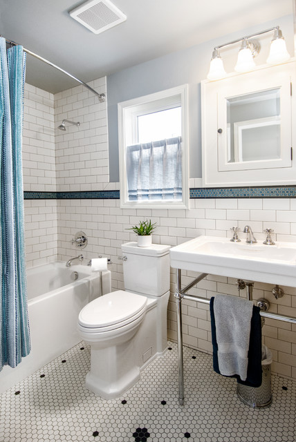 Example of a mid-sized classic white tile and ceramic tile ceramic floor and white floor bathroom design in Seattle with a one-piece toilet, blue walls and a console sink