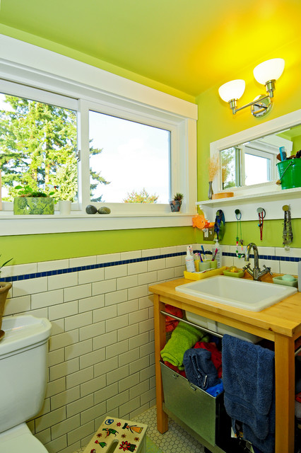 Example of an arts and crafts kids' white tile and ceramic tile ceramic floor bathroom design in Seattle with a drop-in sink, open cabinets, light wood cabinets, wood countertops, a two-piece toilet and green walls
