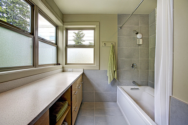 Inspiration for a contemporary gray tile and ceramic tile ceramic floor bathroom remodel in Seattle with an undermount sink, flat-panel cabinets, light wood cabinets, engineered quartz countertops, a two-piece toilet and green walls