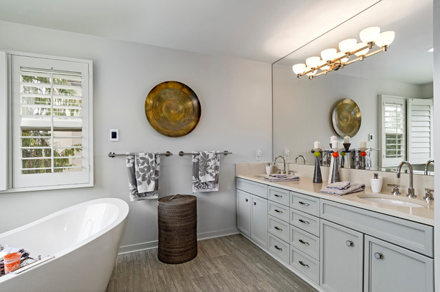 Bathroom - large transitional master beige tile and glass tile porcelain floor and gray floor bathroom idea in Seattle with recessed-panel cabinets, gray cabinets, a one-piece toilet, gray walls, a vessel sink, engineered quartz countertops and a hinged shower door
