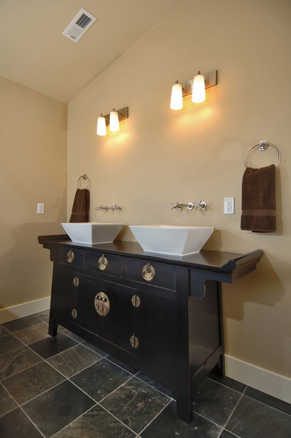 Master multicolored tile and stone tile slate floor bathroom photo in Seattle with a vessel sink and beige walls