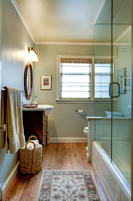 Elegant white tile and porcelain tile medium tone wood floor bathroom photo in Seattle with an integrated sink, flat-panel cabinets, dark wood cabinets, a two-piece toilet and gray walls