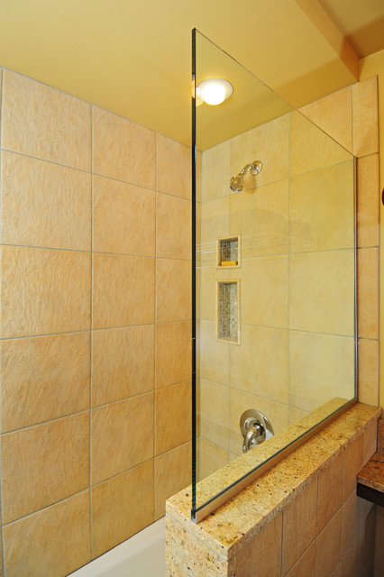 Bathroom - contemporary master beige tile and stone tile limestone floor bathroom idea in Seattle with an undermount sink, flat-panel cabinets, medium tone wood cabinets, granite countertops, a two-piece toilet and beige walls