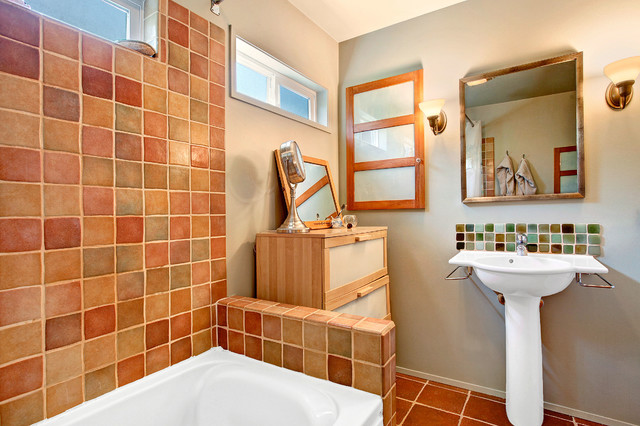 Example of an eclectic multicolored tile and ceramic tile ceramic floor bathroom design in Seattle with a pedestal sink, furniture-like cabinets, light wood cabinets, a two-piece toilet and gray walls