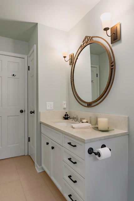 Bathroom - mid-sized transitional gray tile and porcelain tile porcelain floor and beige floor bathroom idea in Seattle with recessed-panel cabinets, gray cabinets, a one-piece toilet, gray walls, an undermount sink and engineered quartz countertops