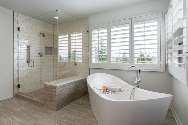 Inspiration for a large transitional master beige tile and glass tile porcelain floor and gray floor bathroom remodel in Seattle with recessed-panel cabinets, gray cabinets, a one-piece toilet, gray walls, a vessel sink, engineered quartz countertops and a hinged shower door