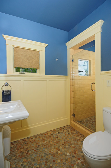 Example of an arts and crafts 3/4 multicolored tile and stone tile slate floor alcove shower design in Seattle with a pedestal sink, a two-piece toilet and blue walls
