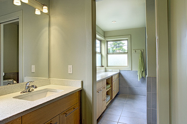 Bathroom - contemporary gray tile and ceramic tile ceramic floor bathroom idea in Seattle with an undermount sink, flat-panel cabinets, light wood cabinets, engineered quartz countertops, a two-piece toilet and green walls