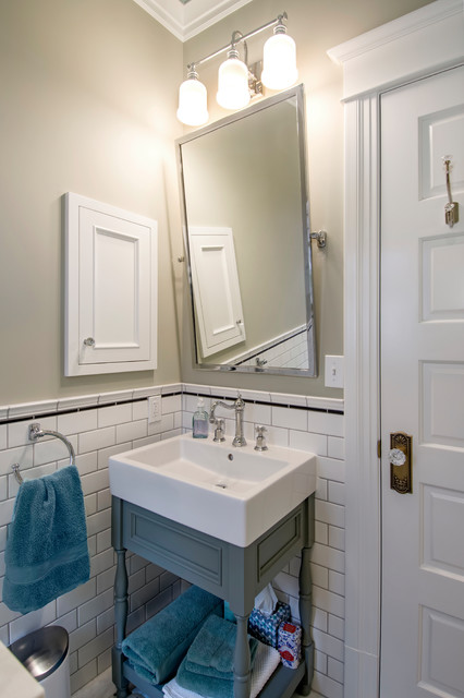 Example of a small arts and crafts 3/4 white tile and ceramic tile marble floor and white floor corner shower design in Seattle with furniture-like cabinets, gray cabinets, a one-piece toilet, gray walls, a vessel sink and a hinged shower door