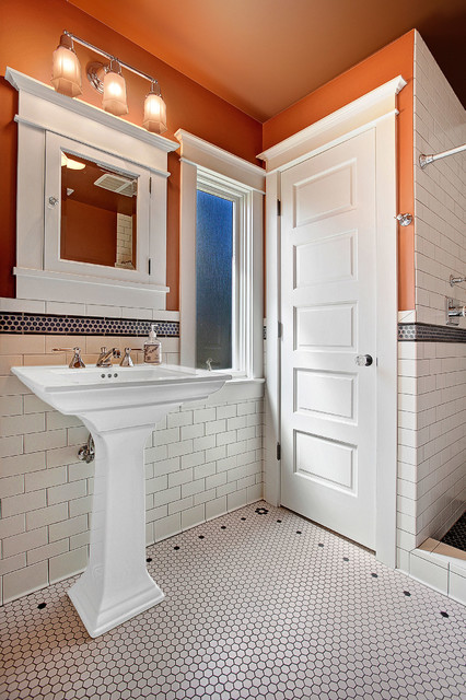Inspiration for a craftsman 3/4 white tile and ceramic tile ceramic floor alcove shower remodel in Seattle with a pedestal sink, a two-piece toilet and orange walls