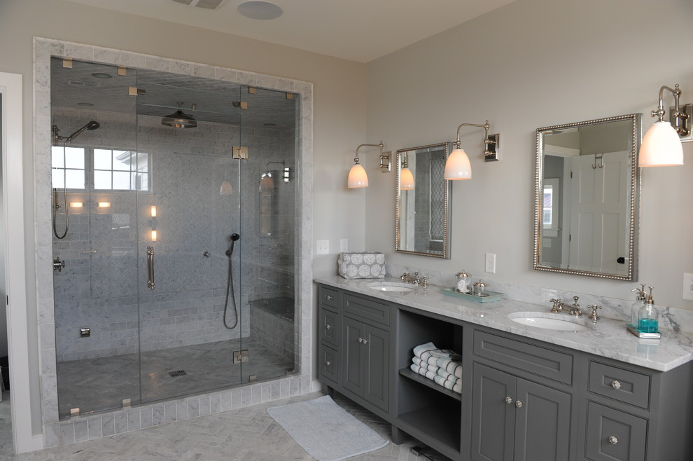 Large transitional master gray tile and marble tile marble floor and gray floor bathroom photo in New York with gray cabinets, beige walls, an undermount sink, a hinged shower door, beaded inset cabinets and marble countertops