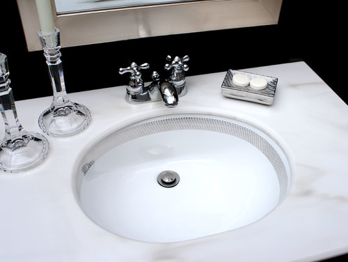 Silver Border Chain Maille sink in black bathroom