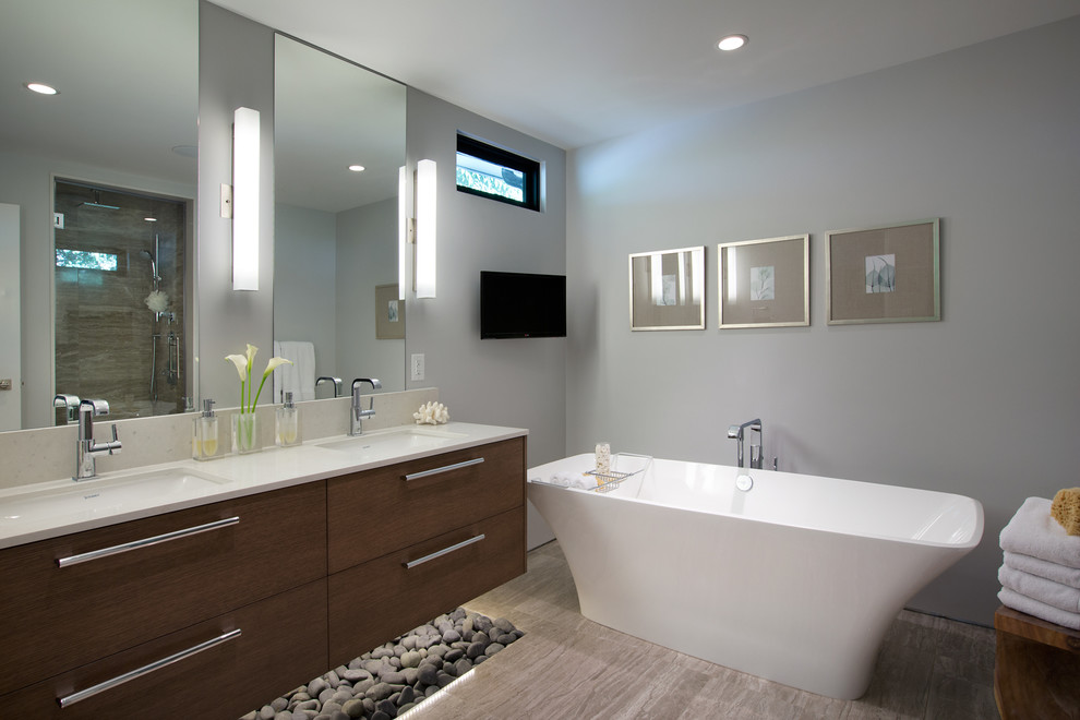 Mid-sized minimalist master porcelain floor freestanding bathtub photo in Vancouver with an undermount sink, flat-panel cabinets, dark wood cabinets, gray walls, engineered quartz countertops and white countertops