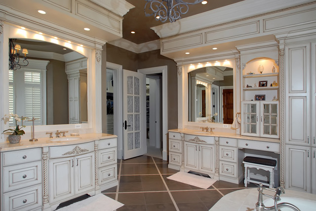 Example of a classic beige tile bathroom design in Chicago with an undermount sink, raised-panel cabinets and beige cabinets