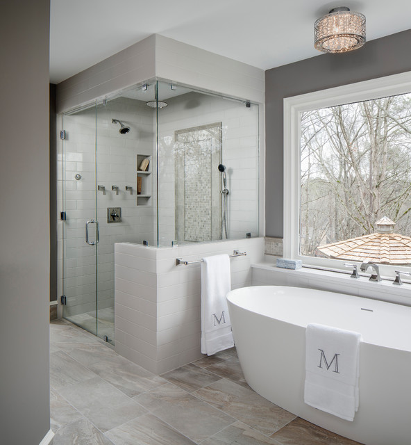 Inspiration for a large transitional master gray tile and ceramic tile porcelain floor and gray floor bathroom remodel in Atlanta with gray walls, a hinged shower door, flat-panel cabinets, gray cabinets, a two-piece toilet, an undermount sink and engineered quartz countertops