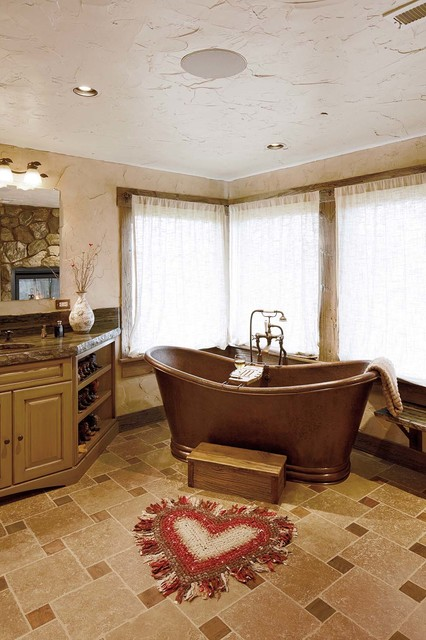 Bathrooms southwestern bathroom by magnolia design for Home automation shower