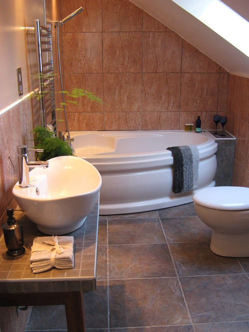 Corner bath tubs are big in small spaces for Bathroom designs with corner bath