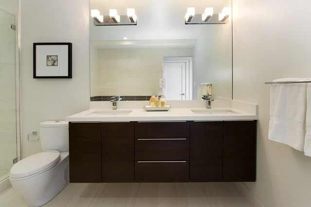 inspiration for a contemporary beige tile bathroom remodel with an undermount sink flat panel - Mirror Bathroom