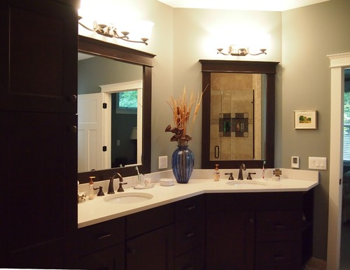 in smaller bathrooms an lshaped vanity can extend the space just enough to