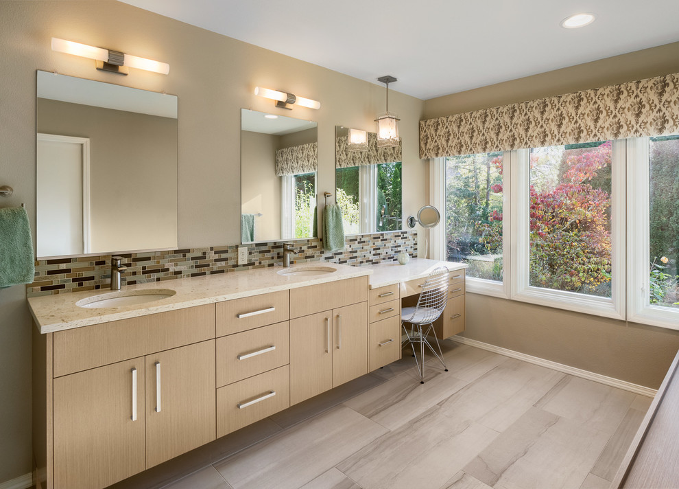 Inspiration for a large transitional master beige tile and mosaic tile porcelain floor double shower remodel in Portland with flat-panel cabinets, light wood cabinets, a two-piece toilet, beige walls, an undermount sink and engineered quartz countertops