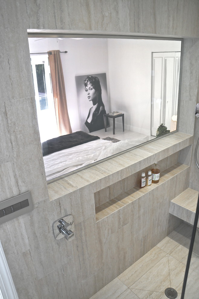 Example of a large minimalist master beige tile and ceramic tile ceramic tile doorless shower design in Miami with an undermount sink, open cabinets, medium tone wood cabinets, quartzite countertops, a wall-mount toilet and beige walls